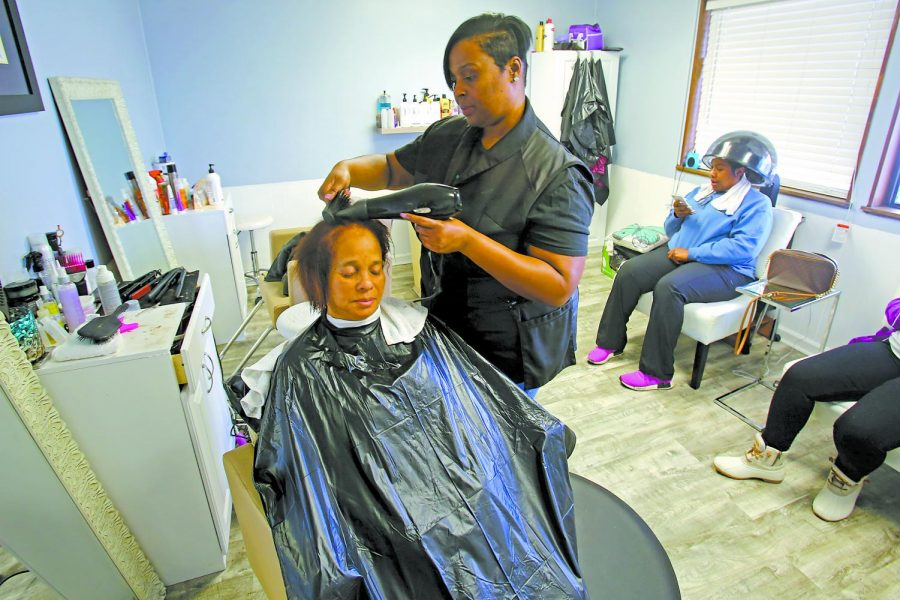 Bolling dries a client's hair on January 24, 2020. Bolling said after her mother died of cancer, she found baking made her feel close to her mother.