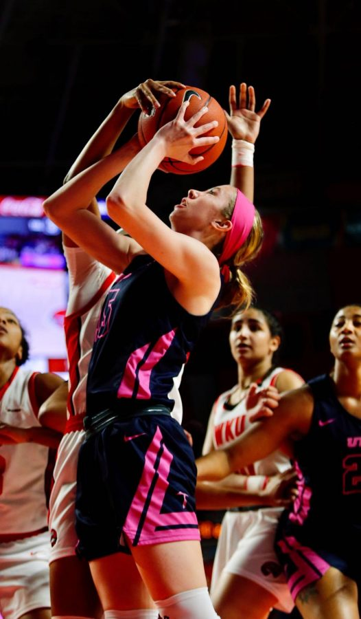 Miner guard Avery Crouse (15) gets her shot attempt blocked by a Lady Topper defender during the women's basketball game against UTEP on Thursday, Feb. 13.