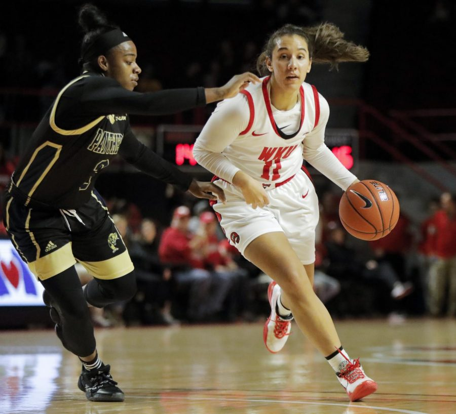 Western+Kentucky+University+Lady+Toppers+guard+Alexis+Brewer+%2811%29+takes+the+ball+inside+the+zone+against+FIU+in+Diddle+Arena+on+Saturday%2C+Feb.+1%2C+2019.+WKU+won+71-51.