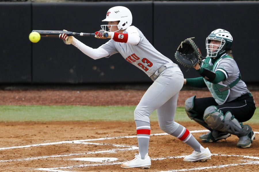 WKU second baseman Morgan Mcelroy bunts the ball while at bat in attempt to take first base on February 23, 2019. WKU defeated the University of Wisconsin-Green Bay 3-0.