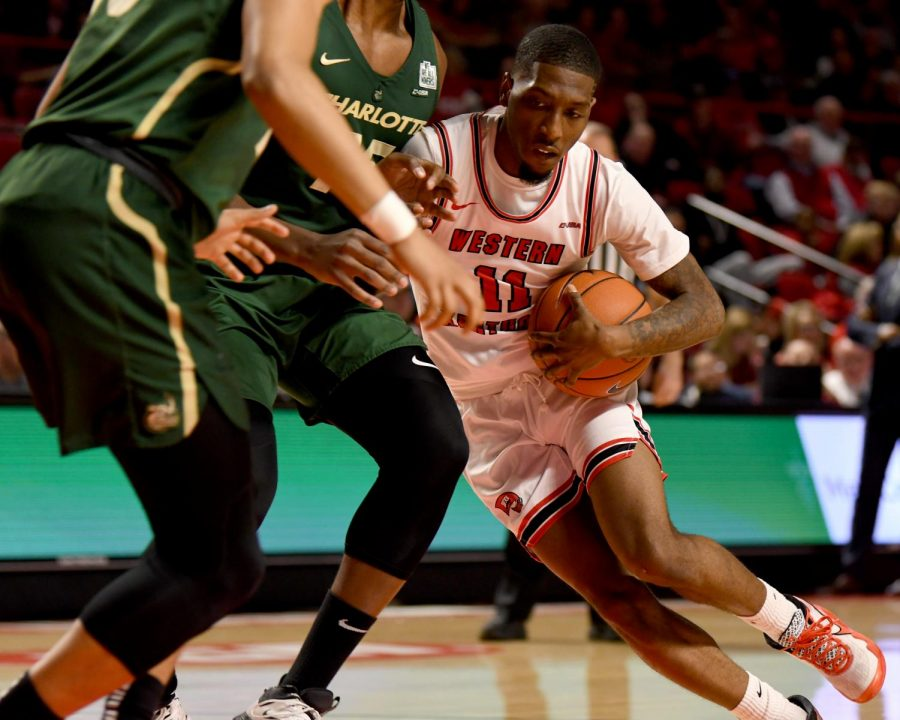 WKU guard Taveion Hollingsworth (11) tries to move inside at the Charlotte v WKU basketball game on Feb 22, 2020 in Diddle Arena. The Hilltoppers were defeated 72-20.