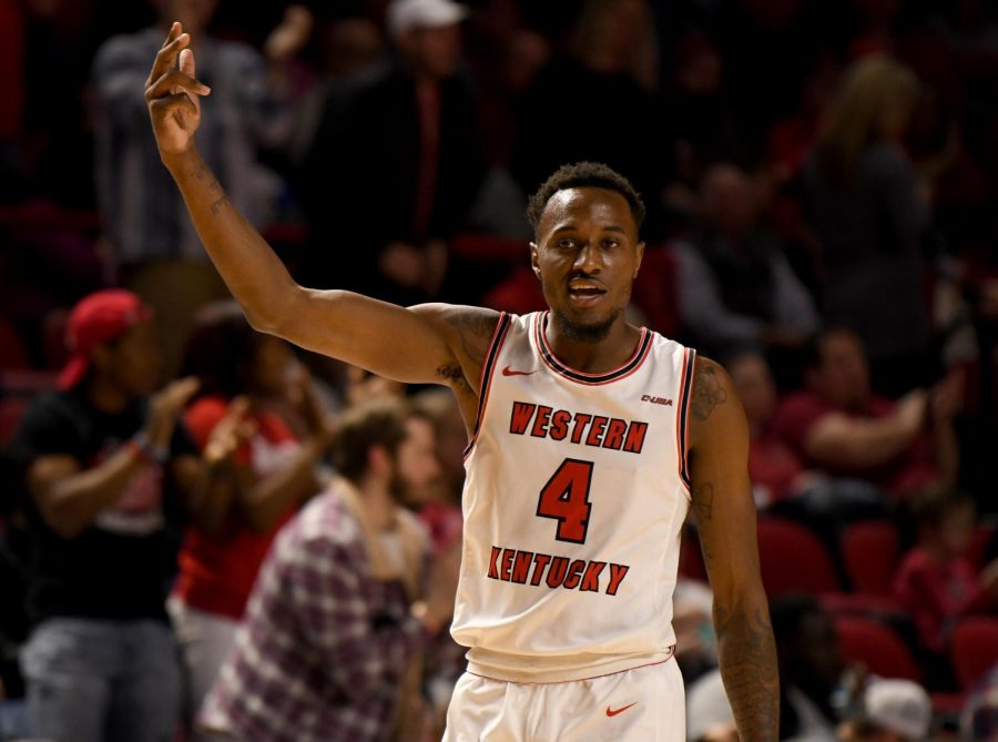 WKU guard Josh Anderson (4) encourages the crowd to get louder after the referees made a call against Charlotte at the Charlotte v WKU basketball game on Feb 22, 2020 in Diddle Arena. The Hilltoppers were defeated 72-20.