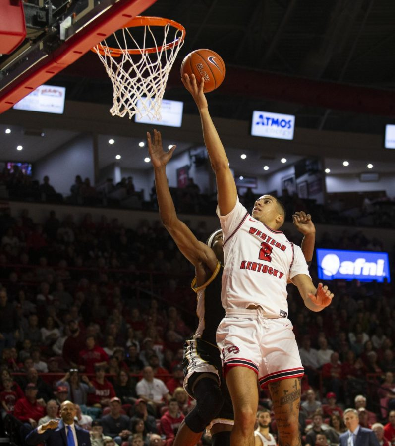 WKU's Jared Savage (2) goes for a lay-up during the men's basketball game against Southern Miss on Feb. 8, 2020 in Diddle Arena. WKU won 75-72.