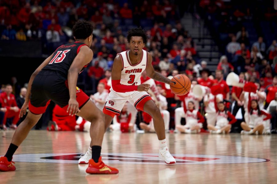 WKU+freshman+guard+Jordan+Rawls+%283%29+looks+for+an+open+teammate+while+being+guarded+by+Louisville+freshman+guard+David+Johnson+%2813%29.%C2%A0The+Cardinals+defeated+the+Hilltoppers+71-54+in+Bridgestone+Arena+on+Sunday%2C+Nov.+17%2C+2019%2C+in+Nashville.