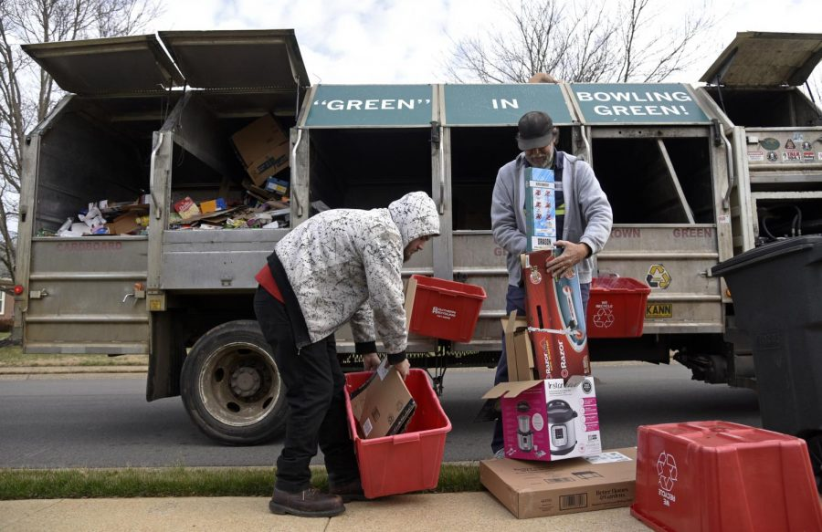 A recycling truck rolls through a Bowling Green neighborhood on the morning of Monday, February 3, 2020. The city of Bowling Green prepares to stop accepting any recycling in early March; as the process is far more expensive than any revenue that the company, Southern Recycling, is able to make.