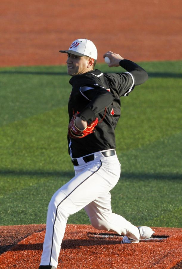 Redshirt junior pitcher Michael Darrell-Hicks (15) delivers a pitch against Wright State on Feb. 21, 2020 at Nick Denes Field.