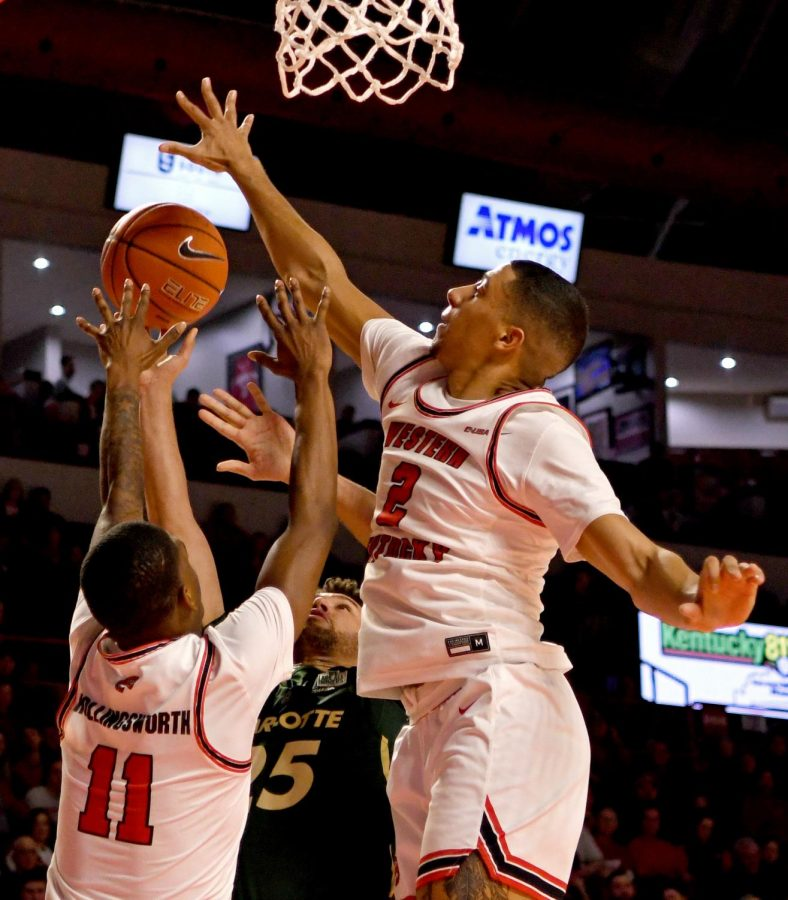 WKU guards Jared Savage (2) and Taveion Hollingsworth (11) attempt to block Charlotte guard Drew Edwards (25) from making a basket at the Charlotte v WKU basketball game on Feb 22, 2020 in Diddle Arena. The Hilltoppers were defeated 72-70.