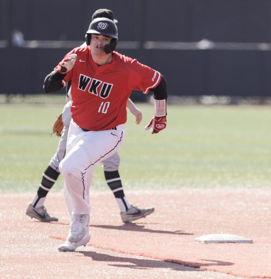 WKU's Davis Sims (10) rounds second base against Wright State on Feb. 22, 2020 at Nick Denes field. WKU won 7-2.