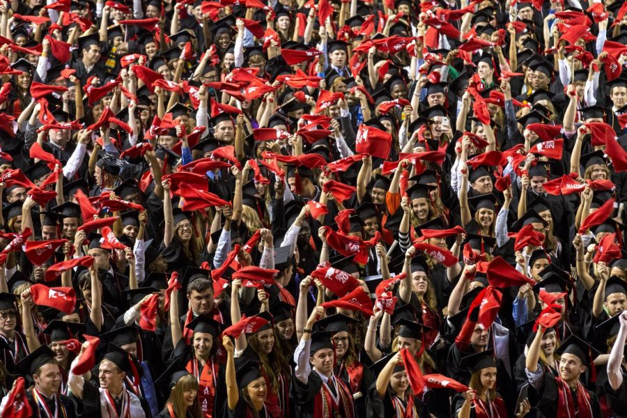 New graduates wave their red towels after receiving their diplomas during the commencement ceremony for WKUs University College and Potter College of Arts and Letters Saturday May 16, 2015, at E.A. Diddle Arena in Bowling Green, Ky.
