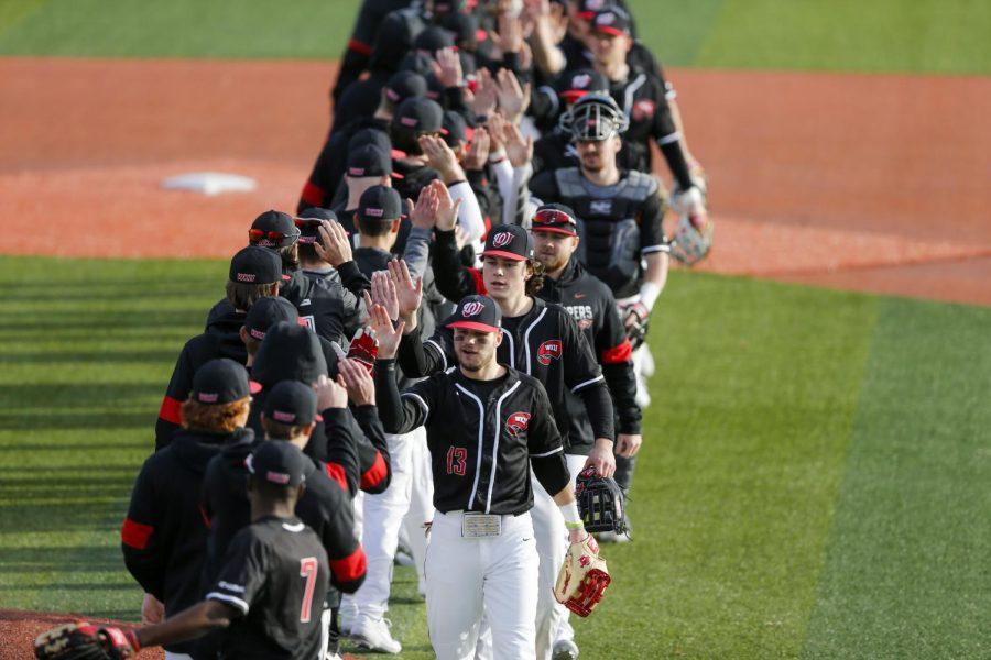 The WKU baseball team celebrates their home opener victory against Valparaiso at Nick Denes field on Feb. 15, 2020. WKU won 9-3.