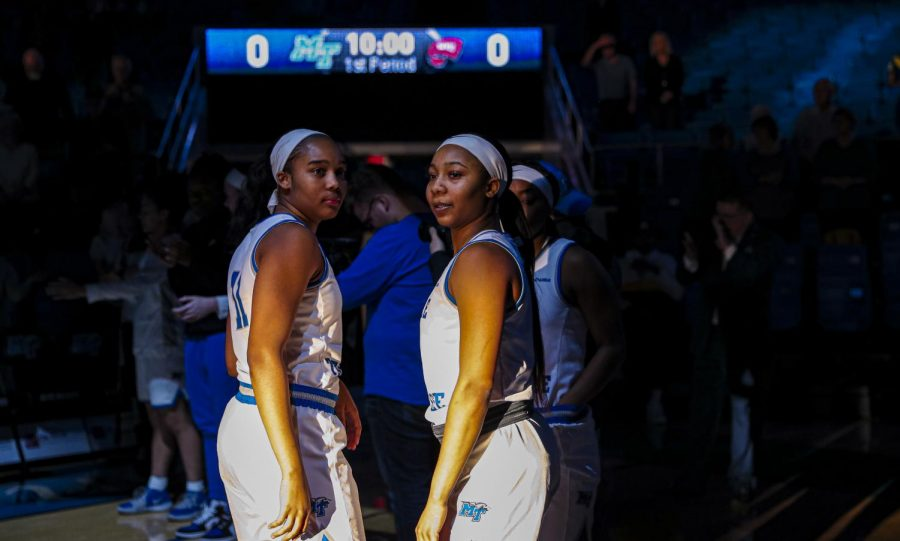 MTSU+freshman+guard+Aislynn+Hayes+%2811%29+and+redshirt+sophomore+guard+Anastasia+Hayes+%281%29+await+the+start+of+the+Blue+Raiders+women%27s+basketball+game+against+WKU+in+the+Murphy+Center+on+Feb.+29%2C+2020.+The+Hayes+sisters+went+on+to+accumulate+a+combined+62+points%2C+15+rebounds+and+nine+assists+in+99+minutes+played+between+the+two.