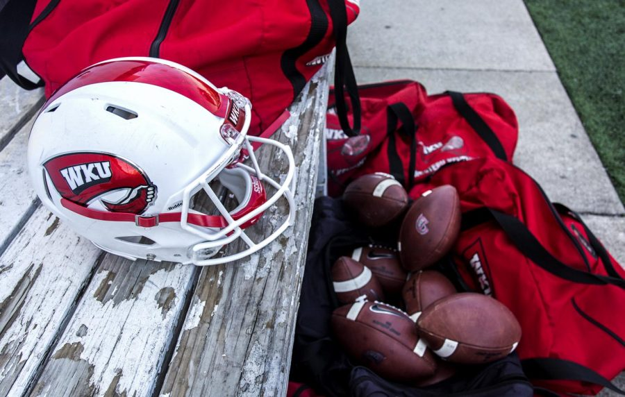 Football+gear+sits+on+the+sidelines+of+Feix+Field+during+the+Red+vs.+White+game+on+April+21.