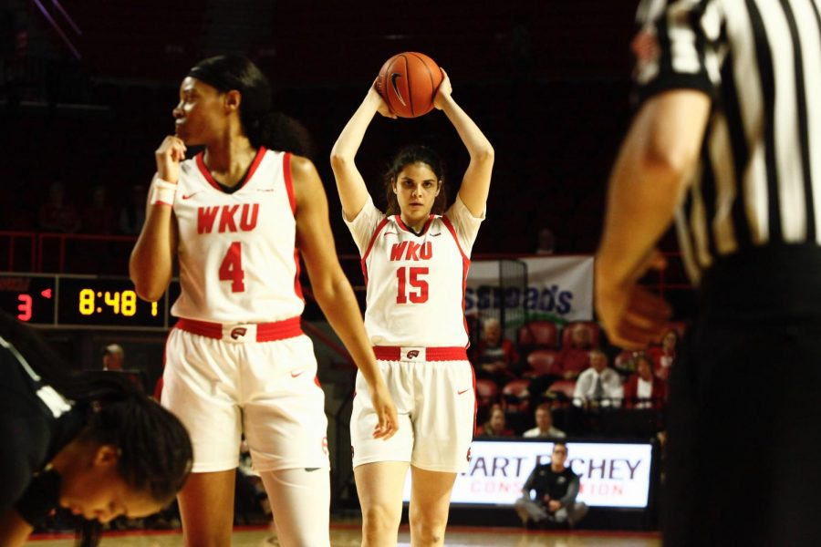 WKU Lady Topper, Raneem Elgedawy holds the ball above her head during the game against the Charlotte 49ers on Thursday, March 5. WKU won 71-60.