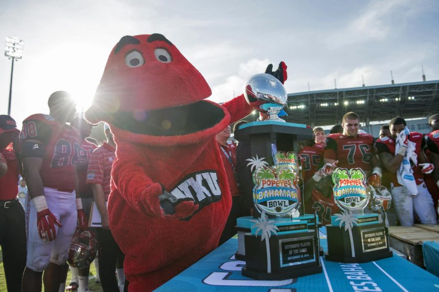 Big Red poses with the Popeyes Bahamas Bowl Trophy after the inaugural bowl game in Nassau on Wednesday, Dec. 24, 2014.