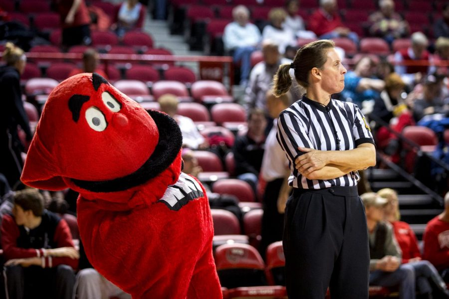 Big Red sneaks behind referee Kelly Dennis during the second half of the Lady Topper's 80-71 victory over the University of Louisiana Lafayette Wednesday, March 5, 2014 at Diddle Arena in Bowling Green, Ky. (Mike Clark/HERALD)