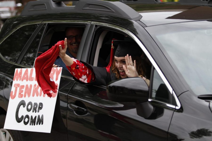 Mallory Jenkins, a graduate of the WKU Department of Communication, waves to her professors at the Colonnade on May 16, 2020. At the time, regular graduation practices were suspended until September due to the coronavirus pandemic.