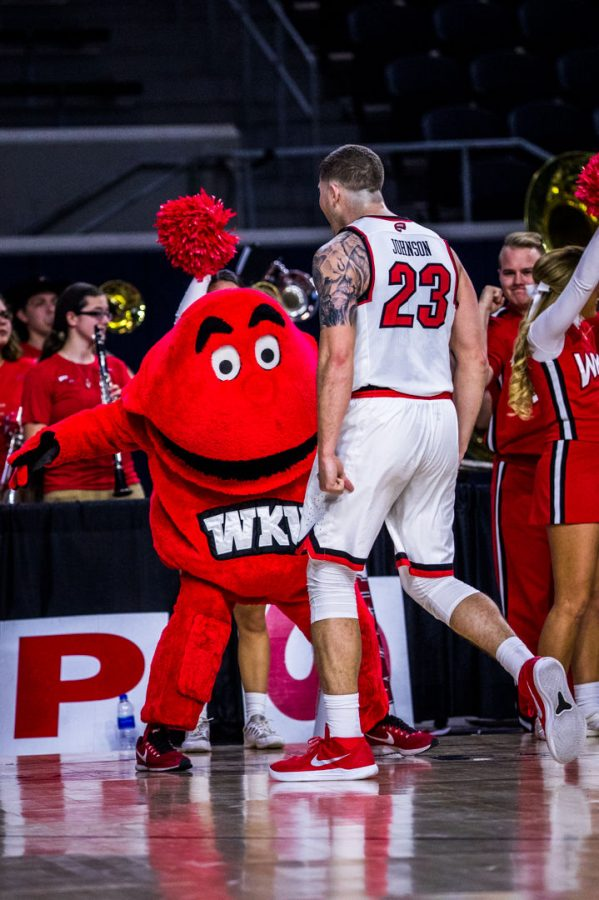 WKU+Forward+Justin+Johnson+%2823%29+celebrates+with+Big+Red+during+the+Hilltoppers+98-70+win+in+their+first+game+of+the+Conference+USA+tournament+against+University+of+Alabama+at+Birmingham+on+Thursday+March+8%2C+2018+at+The+Star+in+Frisco%2C+Tx.