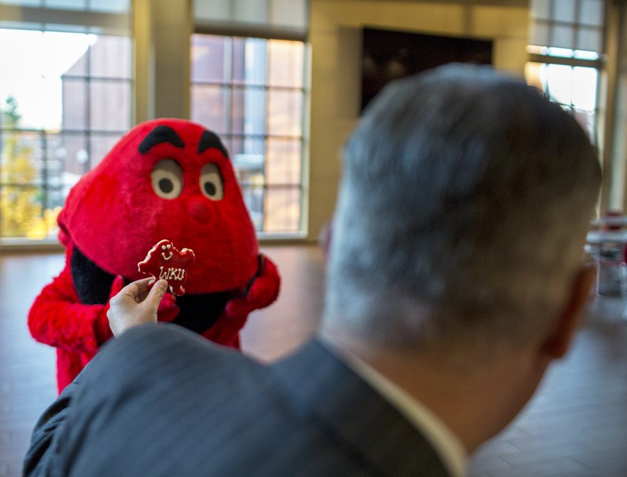 President Timothy Caboni compares a cookie to Big Red at a holiday event put on for students on Nov. 17, 2017 in DSU. President Timothy Caboni ate cookies and talked with students celebrating the end of the semester and the beginning of the holiday season in DSU on Nov. 27.