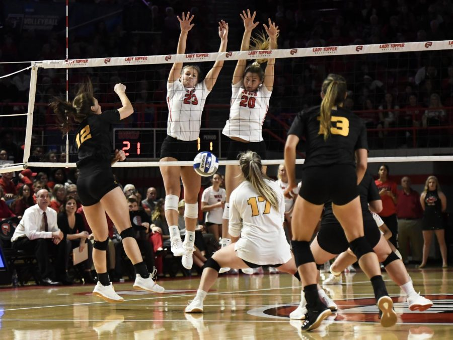 WKU+sophomore+Katie+Isenbarger+%2820%29+and+senior+Sophia+Cerino+%2823%29+combine+for+a+block+during+the+Lady+Toppers+NCAA+Volleyball+Tournament+First+Round+match+against+Kennesaw+State+in+Diddle+Arena+on+Dec.+5%2C+2019.+The+Lady+Toppers+swept+the+Owls%2C+3-0.