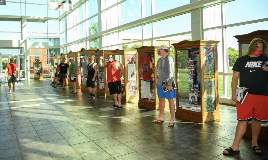 WKU football players lined up in the lobby of Houchens-Smith stadium. Photo courtesy of Steve Roberts, WKU Athletics.