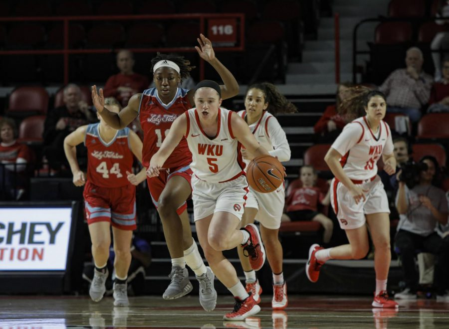 Lady Toppers' Whitney Creech (5) steals the ball from Lady Techsters' Amber Dixon (10) during the WKU versus LA Tech game at E.A. Diddle Arena on Mar. 7, 2020. Lady Toppers won 71-67