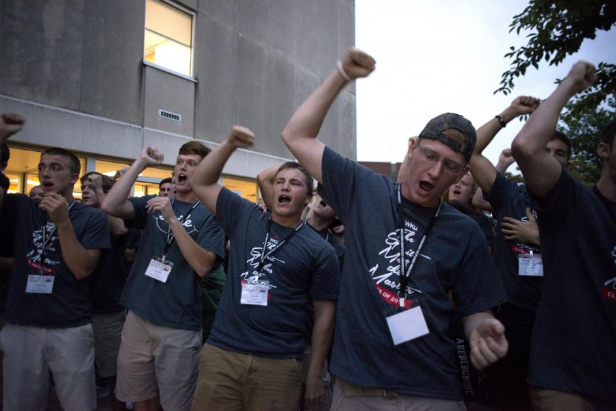 Minton Hall MASTER Plan students practice cheers learned at the H4 Honors retreat before heading to Diddle Arena for the MASTER Plan convocation. Hundreds of WKU freshman move in early for MASTER Plan.William Kolb/HERALD