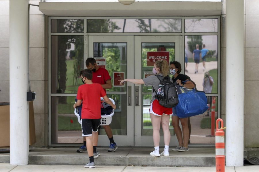 A student directs family members while moving into McCormack Hall on Wednesday, August 19, 2020.