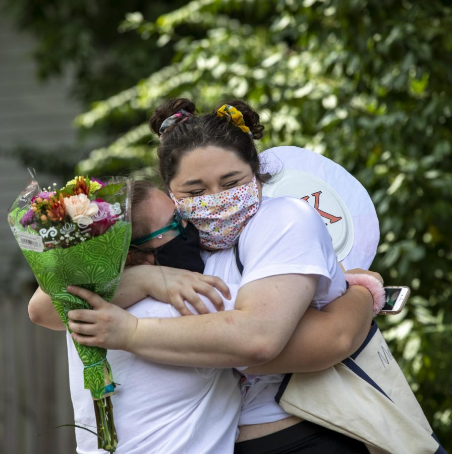 Macey Montgomery, member of Sigma Kappa, hugs her sorority sister, Mallory Jent, close on Bid Day at Sigma Kappa on Tuesday, Aug.18, 2020 in Bowling Green, KY. This was their first in-person meeting since school disbanded earlier this year in March.