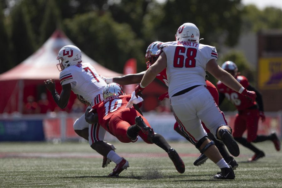 WKU Senior lineman Deangelo Malone (10) attempts to tackle Liberty Junior Malik Willis (7) during the WKU home opener in Houchens-Smith Stadium on September 19, 2020. The WKU Hilltoppers lost to the Liberty Flames 30-24.