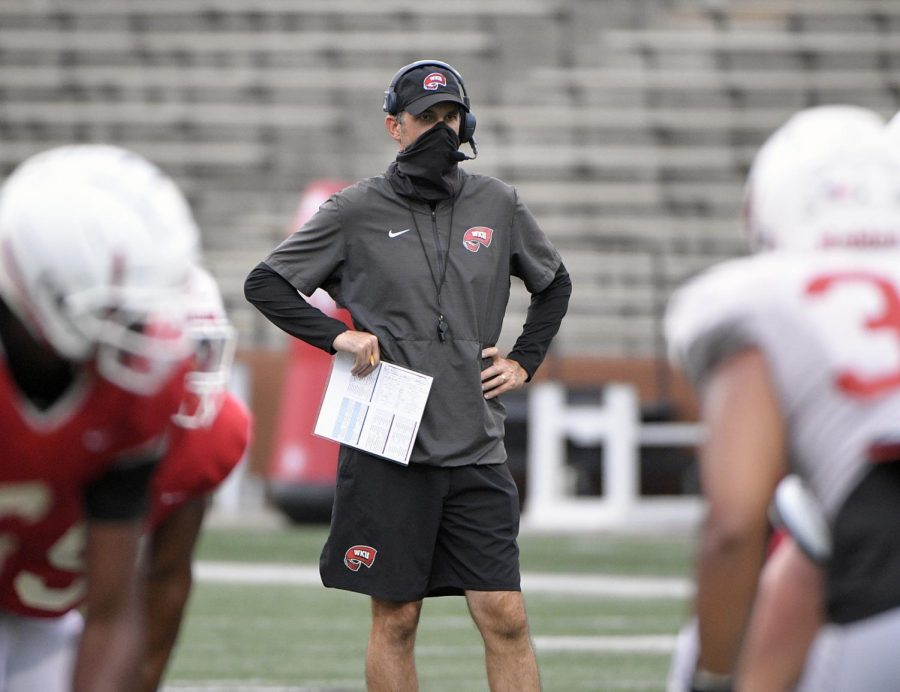 Hilltoppers+football+head+coach+Tyson+Helton+standing+on+the+field+amid+a+team+practice+Sept.+1%2C+2020+in+Houchens-Smith+Stadium.