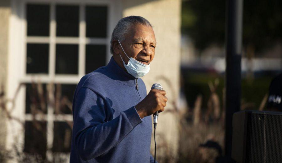 Charles Neblett sings at protest