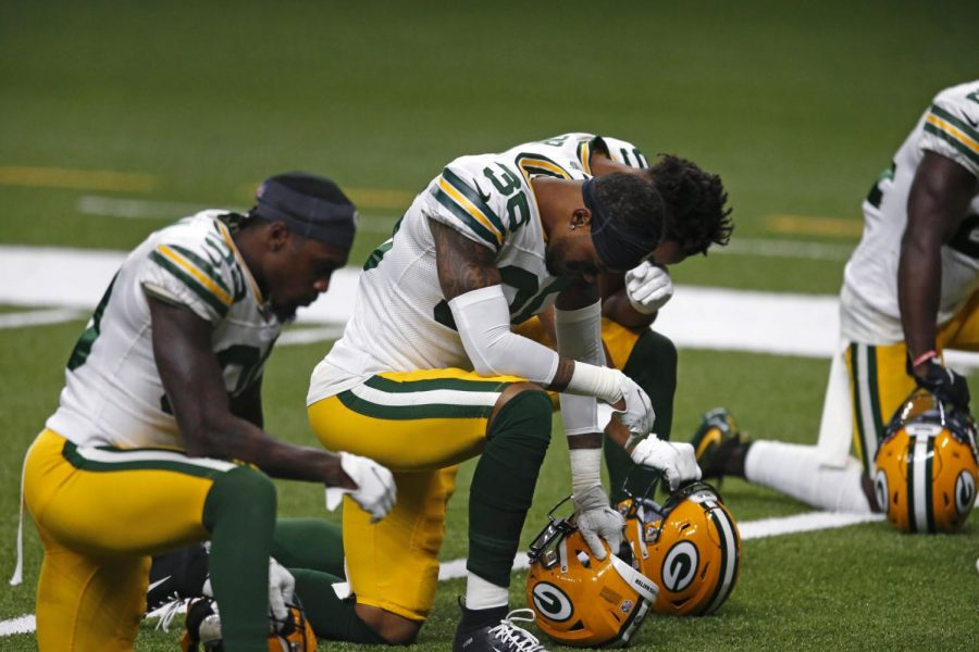 Green Bay Packers defensive back Vernon Scott (36) kneels in the end zone after taking to the field after the National Anthem, before an NFL football game between the New Orleans Saints and the Green Bay Packers in New Orleans, Sunday, Sept. 27, 2020.