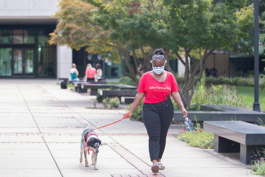 Jalissa Novotney, a senior anthropology major from Chicago and her emotional support animal Hazel Grace outside of Jody Richards Hall on Aug. 25, 2020.