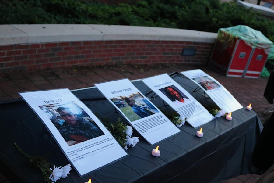 Photos+displayed+of+victims+of+police+killings+during+a+vigil+to+honor+them+in+Centennial+Mall+on+Sept.+1%2C+2020.