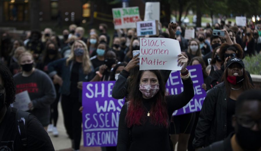 A+woman+holds+up+a+sign+saying+%E2%80%9CBlack+Women+Matter%E2%80%9D+at+a+student+lead+protest+in+response+to+the+indictment+of+former+Louisville+Metro+police+officer+Brett+Hankison+on+three+charges+of+wanton+endangerment+on+Wednesday+September+23%2C+2020.