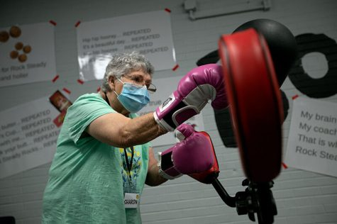 Sharon Young exercises in a workout circuit at the gym on Sept. 10. Rock Steady Boxing helps participants with Parkinson's disease to improve motor skills and balance.