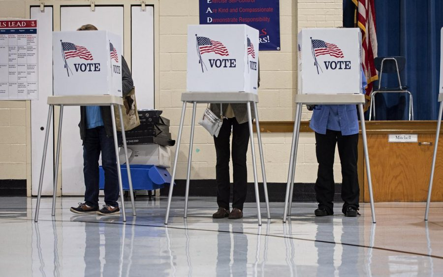 Voters at the McNeill Elementary polling location complete their ballots for the 2019 Kentucky general elections on Nov. 5, 2019. The 2019 Kentucky governor's race has generated national attention with the incumbent Matt Bevin's affiliation with President Trump.