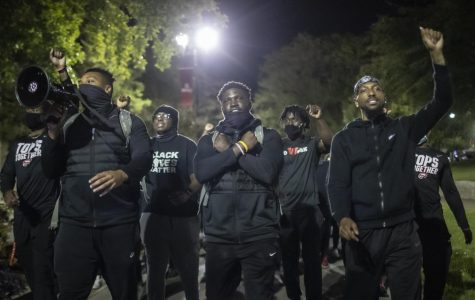 WKU athletes Juwan Jones, Demetrius Cain, and Tavion Hollingsworth lead protesters down Avenue of Champions during the Black Lives Matter protest organized by WKU Athletics on September 30, 2020.