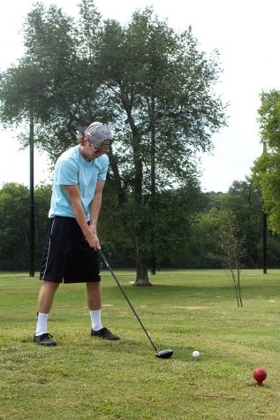 Attempting to perfect his form, Shelbyville senior Casey Warner waits until it feels just right to tee off while learning to golf at Hobson Golf Course.