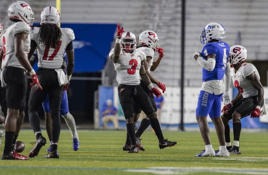 WKU running back Jakairi Moses signals a first down after rushing for 10 yards to the MTSU 34 yard line on Oct. 3, 2020 in Floyd stadium. The Hilltoppers defeated the Blue Raiders 20-17 to advance to 1-2 on the season. Moses finished the night with 5 carries for 36 yards.