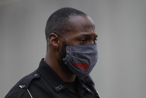 Tim Gray, an officer with the WKU Police Department, stands masked at the colonnade after the drive through ceremony that honored the graduates of the WKU Department of Communication graduates on May 16.