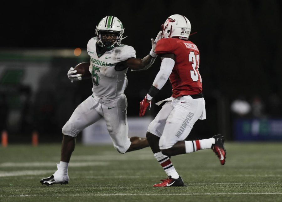 Marshall+running+back+Sheldon+Evans+tries+to+block+Antwon+Kincaid%2C+WKU+defensive+back%2C+as+Evans+runs+with+the+ball+during+the+Marshall-WKU+homecoming+game+on+Oct.+10%2C+2020.%C2%A0