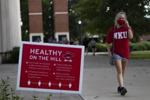 Signs placed around campus remind students how to be safe and stay healthy while on campus by wearing masks and social distancing from other students.