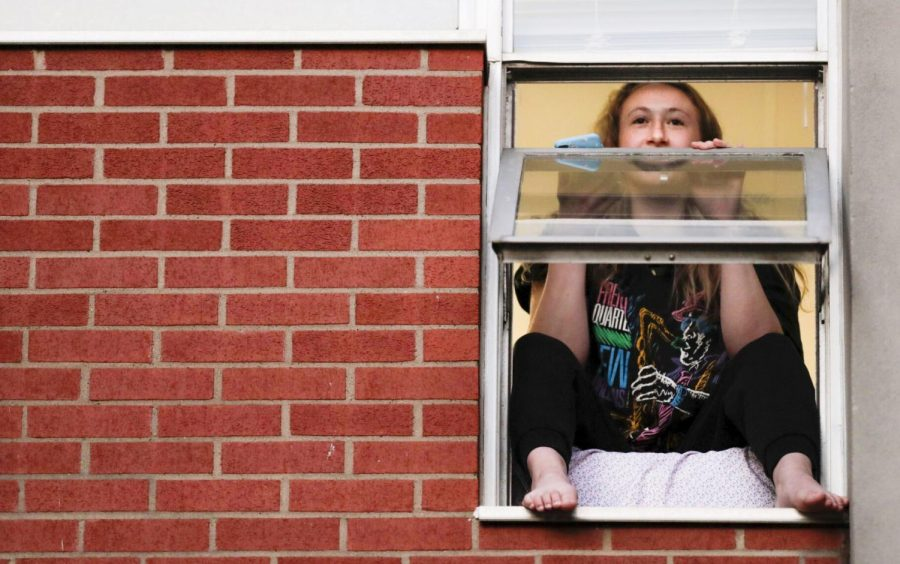 Kate Segrest sits in the windowsill
