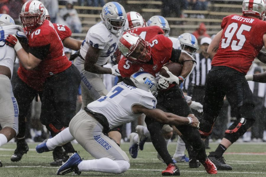 WKU redshirt junior running back Gaej Walker (5) is tackled with the ball while running against MTSU during the game in L.T. Smith Stadium on Saturday, Nov. 30, 2019.