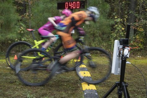 Two women bikers start the race after the men hit the trails in the mountain bike competitions during the eighth annual Trailfest hosted by Graves Gilbert on October 24, 2020 at the Twisted Oliver trails.