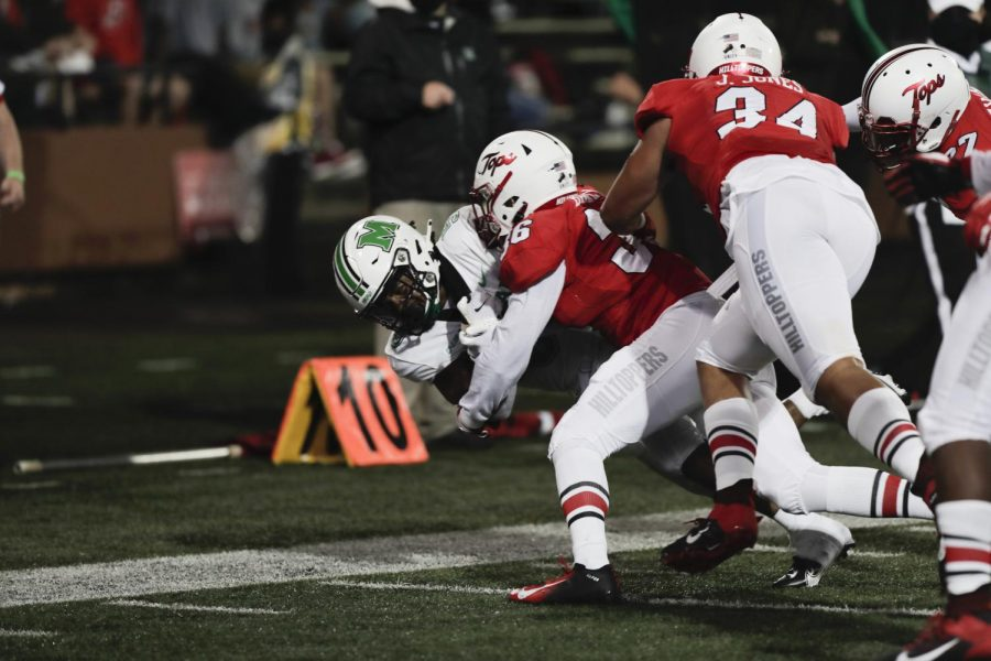 WKU+Hilltoppers+tackle+Marshall+running+back+Sheldon+Evans+%285%29+as+he+attempts+a+touchdown+on+Oct.+10.+WKU+fell+to+Marshall+38+to+14.
