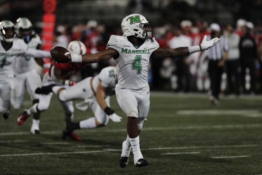 Marshall running back Lawrence Papillon (4) scores a 4th quarter touchdown against WKU on Oct. 10.