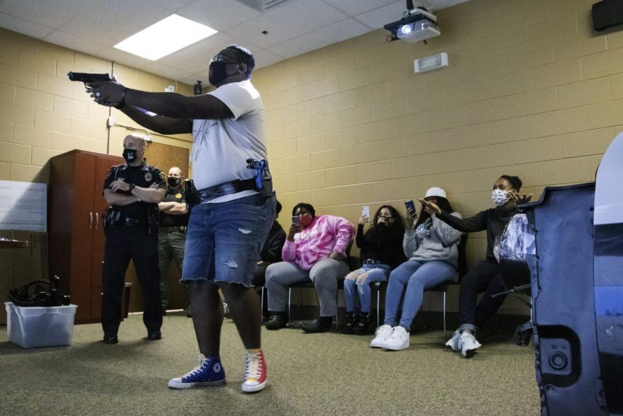 Davon Taylor participates in the Arrest the Fear simulator which places volunteers into various scenarios that a police officer might find themselves in.