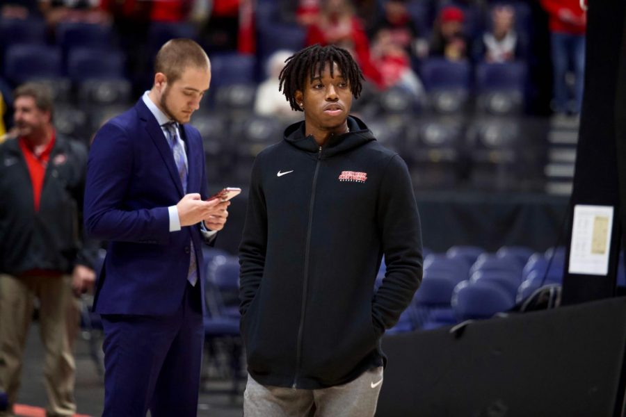 WKU+senior+guard+Kenny+Cooper+looks+toward+the+floor+while+his+team+warms+up+to+play+against+the+Cardinals.%C2%A0The+Cardinals+defeated+the+Hilltoppers+71-54+in+Bridgestone+Arena+on+Sunday%2C+Nov.+17%2C+2019%2C+in+Nashville.